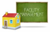 Facility management on Blackboard with 3d house — Stock Photo