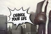 Change your life text with businessman wearing boxing gloves — Stock Photo