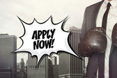 Apply now text with businessman wearing boxing gloves — Stock Photo
