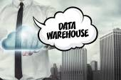 Data warehouse text on cloud computing theme with businessman — Stock Photo