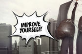 Improve yourself text with businessman wearing boxing gloves — Stock Photo