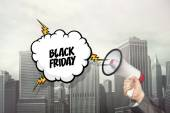 Black friday text on speech bubble and businessman hand holding megaphone — Stock Photo