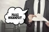 Yeees holidays text on speech bubble with businessman holding paper plane in hand — Stock Photo