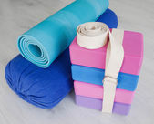 Yoga props blocks, strap, roller and carpet — Stock Photo