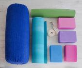 Yoga props blocks, strap, roller and carpet — Stock Photo