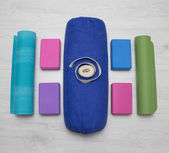 Iyengar yoga props blocks, strap, roller and carpet — Stock Photo