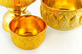 Traditional Thai goldware on isolated white background — Stock Photo