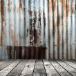 Rusted galvanized iron plate with wood floor — Stock Photo #57959761