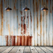 Lamp at Rusted galvanized iron plate with wood floor — Stock Photo #57959931