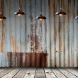 Lamp at Rusted galvanized iron plate with wood floor — Stock Photo #57959939