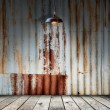 Lamp at Rusted galvanized iron plate with wood floor — Stock Photo #57959947