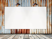 Blank frame on Rusted galvanized iron plate with wood floor — Stock Photo