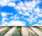 Paving vintage wood floor with cloud and blue sky — Stock Photo