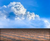 Cement brick floor with cloud and blue sky — Stock Photo