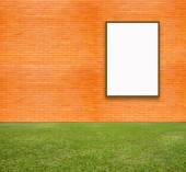 Blank Poster with brick wall and green lawn for information message — Stock Photo