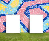 Blank Poster with Colorful mosaic tile wall and green lawn for information message — Photo