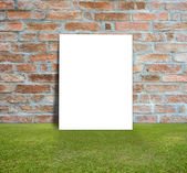Blank Poster with brick wall and green lawn for information message — Foto Stock
