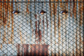 Lamp with wired fence and Rusted iron plate — Stock Photo