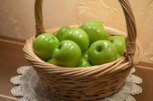 Green apples in basket, selective focus — Stock Photo