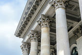 Columns in front of facade roof — Stock Photo