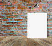 Blank frame on brick wall and wood floor for information message — Stock Photo