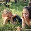 Girl with her mommy having fun on grass — Stock Photo #61086109