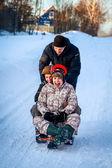 Young people fun sledding — Foto de Stock