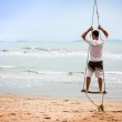 Happy man looking into the distance on the beach — Stock Photo #61794979