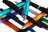 Colourful pens on on ech other — Stock Photo