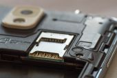 Macro shot of a smartphone where the empty SD card and SIM slot is visible — Stock fotografie