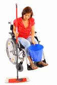 Handicapped woman doing housework — Stock Photo