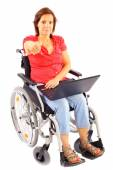 Woman in wheelchair with laptop — Stock Photo