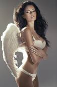 Sexy brunette angel with perfect tawny skin — Stock Photo