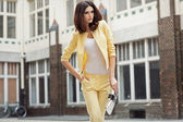 Smart brunette lady clothed yellow suit — Stock Photo