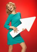 Blond woman with the conceptual white arrow — Stock Photo