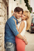 Young hugging couple on the holidays — Stock Photo