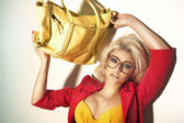 Attractive woman carrying a handbag — Stock Photo