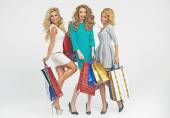 Cheerful friends with plenty of shopping bags — Stock Photo