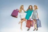 Group of cheerful women enjoying sales — Stock Photo