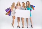 Group of pretty ladies advertising the sale — Stock Photo