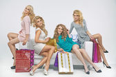Alluring ladies with plenty of shopping bags — Stock Photo
