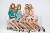 Blond cute ladies on the couch — Stock Photo