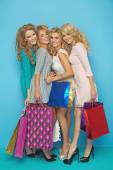 Four attractive girlfriends enjoying shopping sales — Foto Stock