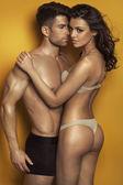 Sexy couple in the sensual scene — Stock Photo