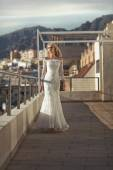 Fashion shot of the bride walking on the terrace — Stock Photo