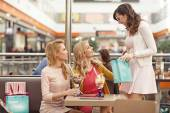 Group of joyous ladies during the shopping — Stock Photo