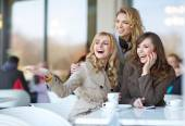Laughing friends in the cofee shop — Foto Stock