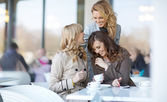 Three relaxed women at the coffee break — Stock Photo