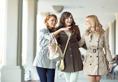 Group of gladsome women laughing together — Stock Photo