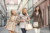 Group of girlfriends walking in the old town — Stock Photo
